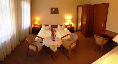 Ein Bett oder Betten in einem Zimmer der Unterkunft Pension an der Havelbucht