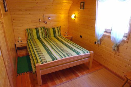 A bed or beds in a room at Chalet House Olga