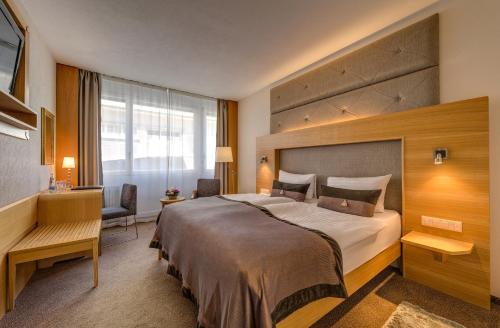 Ein Bett oder Betten in einem Zimmer der Unterkunft Continental Hotel Lausanne