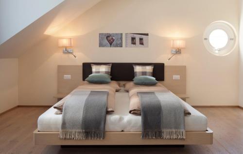 Letto o letti in una camera di Residence Innichen - San Candido