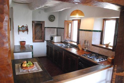 Una cocina o zona de cocina en Casa Maite - Bubión