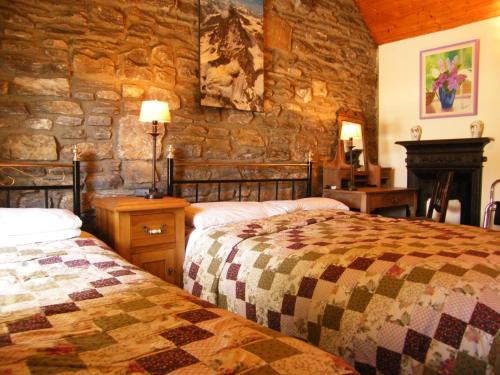 A bed or beds in a room at Druid Cottage
