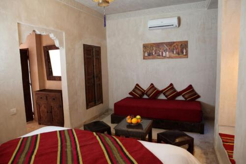 A bed or beds in a room at Les Sources Berbères Riad & Spa