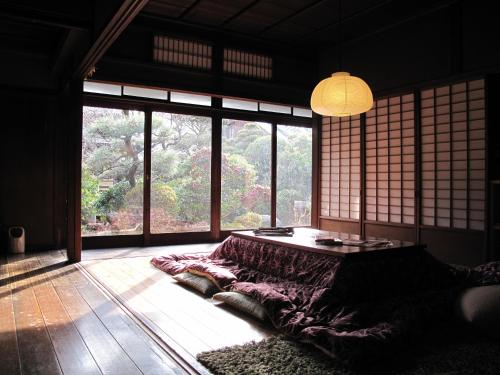 A bed or beds in a room at Guesthouse Nara Backpackers
