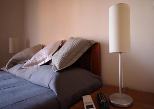 Letto o letti in una camera di Tourist House B&B