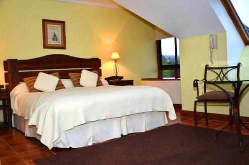 Cama o camas de una habitación en Apart Hotel del Volcan