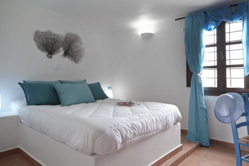 A bed or beds in a room at Anna Traditional Apartments