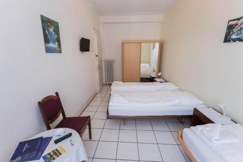 Ein Bett oder Betten in einem Zimmer der Unterkunft Stadthof Budget Hotel Basel City Center