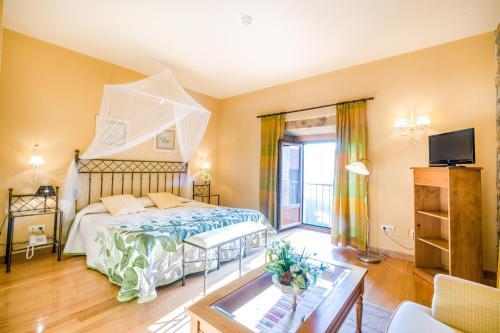 Cama o camas de una habitación en Palacio Garcia Quijano