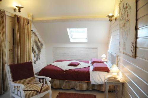 Un ou plusieurs lits dans un hébergement de l'établissement Hotel Vendome