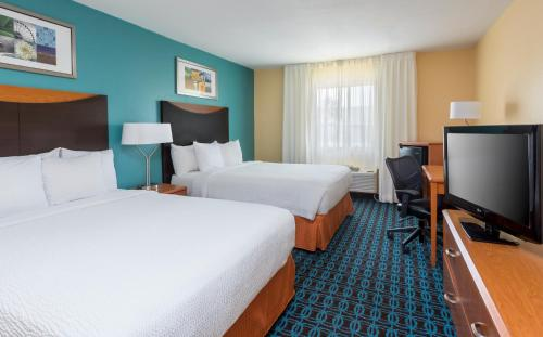 A bed or beds in a room at Fairfield Inn & Suites Corpus Christi