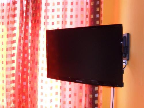 A television and/or entertainment center at Sa Domo de Minnanna