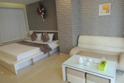 A bed or beds in a room at Luxury Hotel