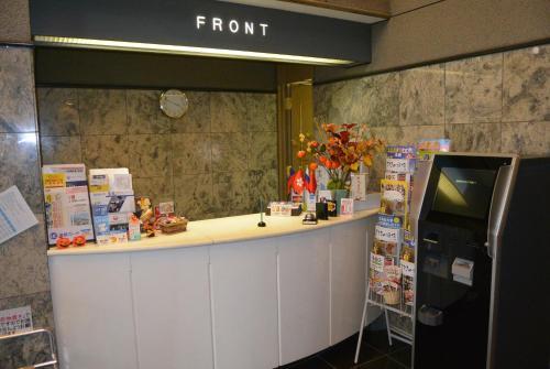 Area lobi atau resepsionis di Business Inn Norte 2