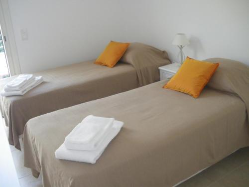 A bed or beds in a room at Residence Gameau