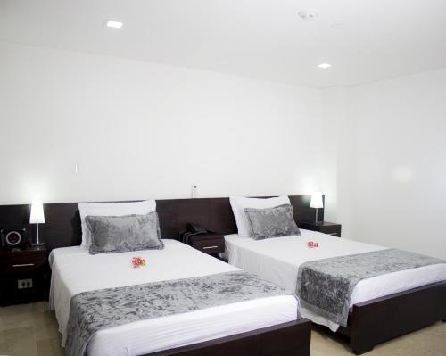 Letto o letti in una camera di Hotel Lleras 10