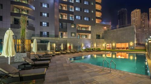 The swimming pool at or near City Premiere Marina Hotel Apartments