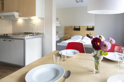 A kitchen or kitchenette at Hotel Copenhagen Apartments