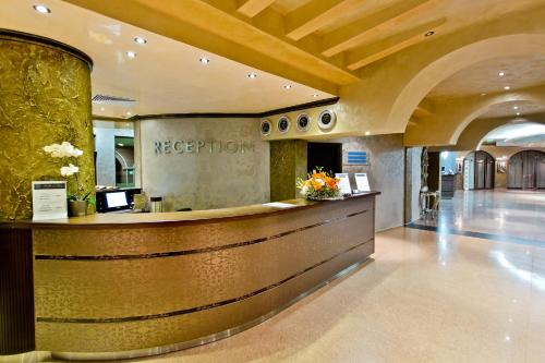 The lobby or reception area at Saint George Palace Hotel