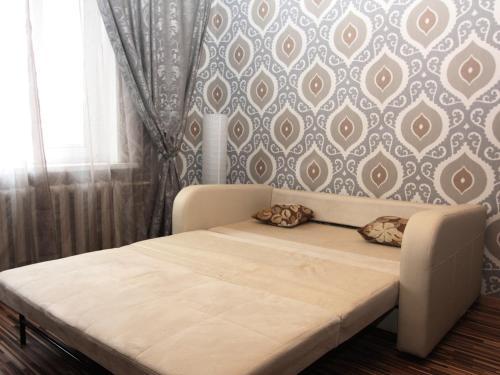 Кровать или кровати в номере ApartLux Третьяковская