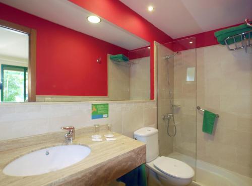 Een badkamer bij Bungalows Cordial Sandy Golf