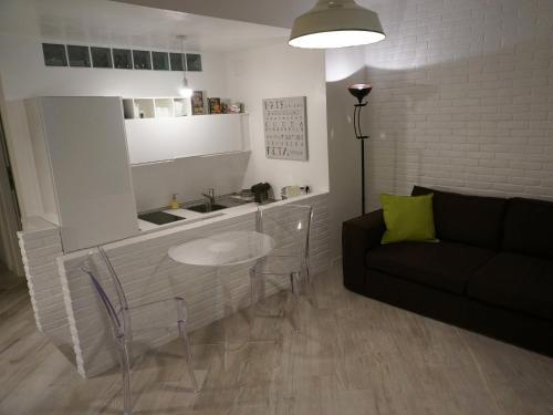 Area soggiorno di Les Suites di Parma - Luxury Apartments