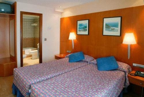 Cama o camas de una habitación en Hotel Restaurante Salvadora