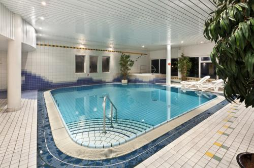 The swimming pool at or near Tryp by Wyndham Bad Bramstedt