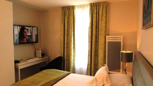 Un ou plusieurs lits dans un hébergement de l'établissement Résidence Champ de Mars