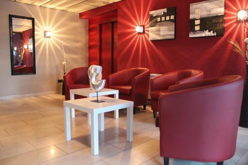 Ein Sitzbereich in der Unterkunft Akzent Hotel Borchers