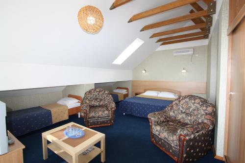 Кровать или кровати в номере Отель ВВВ