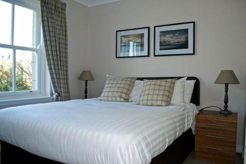 A bed or beds in a room at Loch Ness Guest House