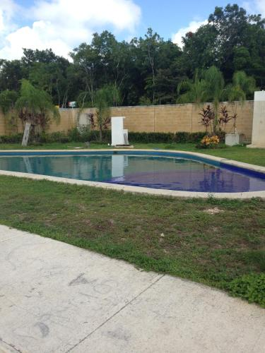 The swimming pool at or near Casa Ela