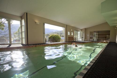 The swimming pool at or near Novotel Lake Crackenback Resort