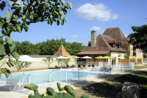 The swimming pool at or near Le Clos des Rives