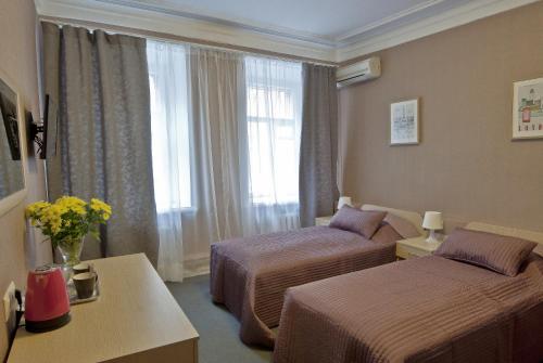 Кровать или кровати в номере Отель Мэрри Поппинс