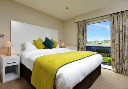 A bed or beds in a room at The View at the White Horse Woolley Moor