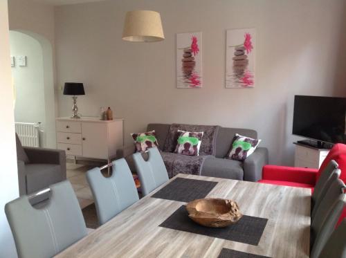 Ein Sitzbereich in der Unterkunft Holiday Home 't Beertje