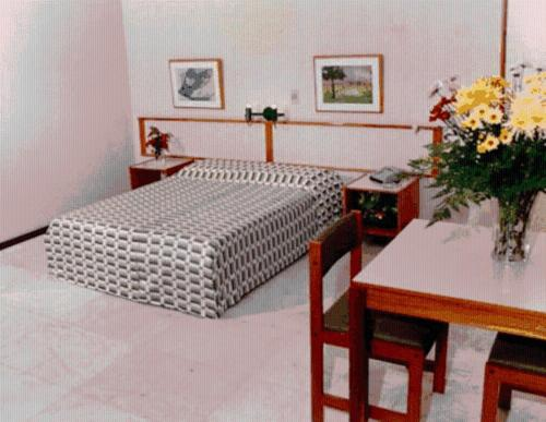 A bed or beds in a room at Ondimar Hotel