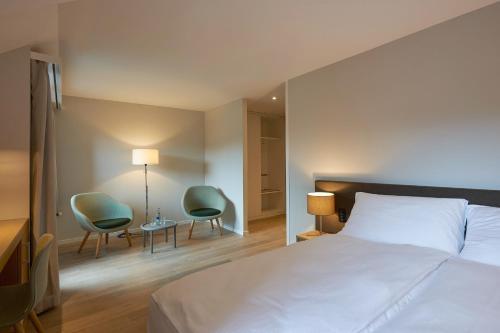Ein Bett oder Betten in einem Zimmer der Unterkunft Parkhotel Wallberg