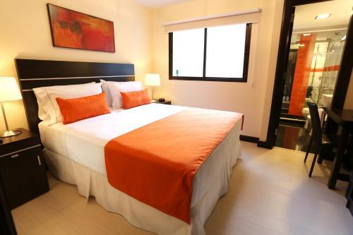 Cama o camas de una habitación en Puerto Mercado Hotel