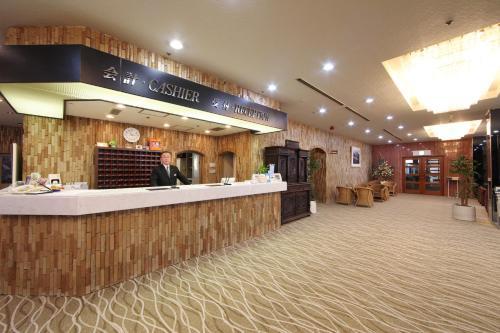 The lobby or reception area at Okido Hotel