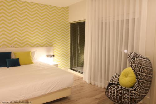 Uma cama ou camas num quarto em Aqua Ria Boutique Hotel