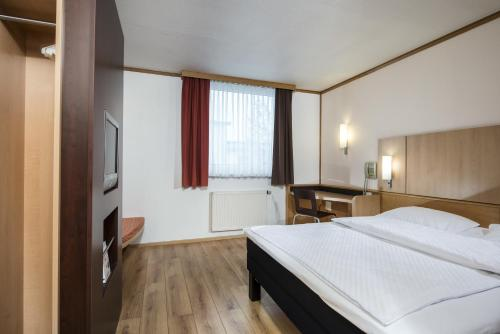 A bed or beds in a room at Good Morning Erfurt
