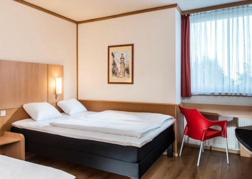 Ein Bett oder Betten in einem Zimmer der Unterkunft ibis Hotel Eisenach