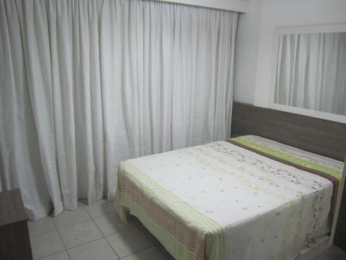 A bed or beds in a room at Studio Home Service em Boa Viagem