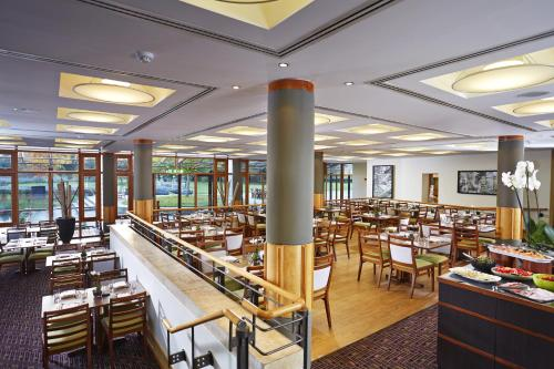 A restaurant or other place to eat at Fanhams Hall, Exclusive Collection
