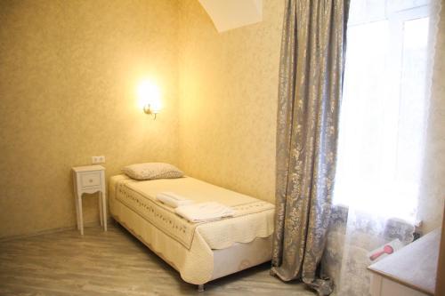 Кровать или кровати в номере Мини Отель Старая Москва