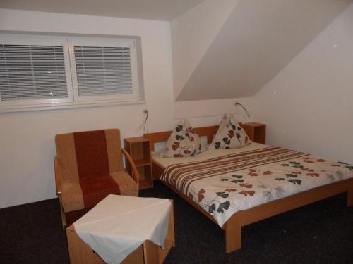 Ein Bett oder Betten in einem Zimmer der Unterkunft Vila Kamila