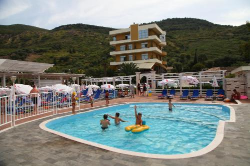 The swimming pool at or near Paradise Beach Hotel
